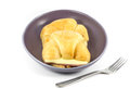 Ham cheese croissants in the plate with fork on white background Royalty Free Stock Image