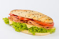 Ham and cheese sandwich long seeded bun with lettuce tomatoes Stock Photo