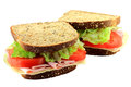 Ham and cheese sandwich on whole grains bread made from slices of garnished with organic fresh sliced tomatoes leaves lettuce Stock Images