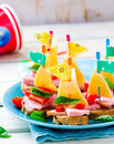Ham and cheese sandwiches in the form of ships Royalty Free Stock Photo