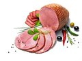 Ham with herbs studio photography of meat products over white background Stock Photography