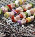 Ham kabobs on the grill kababs cooking Royalty Free Stock Images