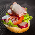Ham salad submarine sandwich from freshly cut baguette Stock Photo