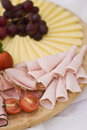 Ham and tomatoes board Stock Photos