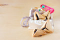 Hamantaschen cookies or hamans ears and noisemaker for purim celebration in wooden box pic Stock Photo