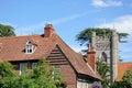 Hambledon church and cottage. Royalty Free Stock Photo