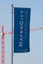 Hamburg hafencity flag and crane germany may of s project for the conversion of former docklands next to construction on may Royalty Free Stock Image