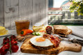 Hamburg, Hearty supper, fried egg and bacon on bread Royalty Free Stock Photo