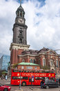 Hamburg hop on hop off tour bus and the st michael s church germany may infront of major landmark at may Stock Photography