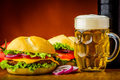 Hamburger and beer still life with traditional homemade Royalty Free Stock Photo