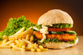 Hamburger big french fries and vegetables Royalty Free Stock Photo