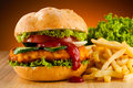Hamburger big french fries and vegetables Stock Images