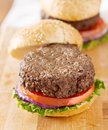 Hamburger with bun off to side. Stock Photos