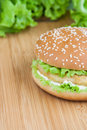 Hamburger with chicken and withe sauce on wooden board Stock Photo