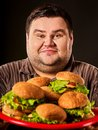 Hamburger eating fast food contest. Fat man eating fast food. Royalty Free Stock Photo