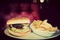 Hamburger and french fries plate in american food restaurant Royalty Free Stock Photo