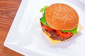 Hamburger with grilled beef cheese and vegetables Stock Photos