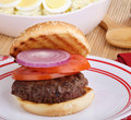 Hamburger On Grilled Bun Royalty Free Stock Photos