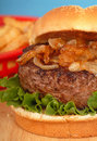 Hamburger with grilled onions Royalty Free Stock Photo