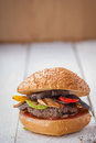 Hamburger with grilled vegetables on white background Royalty Free Stock Photos