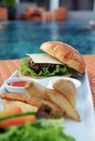 Hamburger at hotel pool Stock Photography