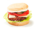 Hamburger isolated on white classic with tomato and lettuce background Stock Images