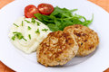 Hamburger with mashed potato,rucola salad Royalty Free Stock Photos