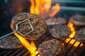 Hamburger meat on barbecue flaming Stock Photography