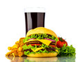Hamburger menu with cheeseburger french fries vegetables and cola drink isolated on a white background Stock Photography