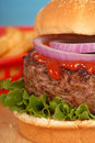 Hamburger with onions and ketchup Stock Images