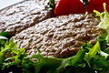 Hamburger with tomatoes,  salad and green beans Royalty Free Stock Images