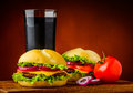 Hamburger vegetables and cola still life with drink Stock Images