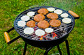 Hamburgers on the bbq baked Royalty Free Stock Photos
