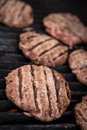 Hamburgers on the grill cooking bbq Stock Image
