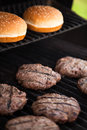 Hamburgers on the grill cooking bbq Stock Photos