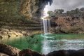 Hamilton pool cloudy day texas waterfall at near austin on a Royalty Free Stock Images