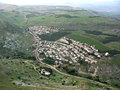Hamlet galilee aerial view of a forming a nucleated settlement on the plains of as seen from mount arbel israel Stock Photos