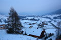 Hamlet in snowy mountains scenic aerial view of or village at dusk winter scene Stock Images