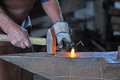 Hammer and anvil blacksmith working on iron at Royalty Free Stock Photos