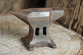 Hammer anvil rusty on a wooden block Stock Image
