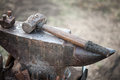 Hammer on blacksmith anvil Royalty Free Stock Photo