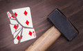 Hammer with a broken card, six of diamonds Royalty Free Stock Photo