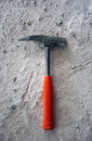 Hammer on cement picture of a Royalty Free Stock Image