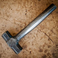 Hammer on dirty wood Royalty Free Stock Photo