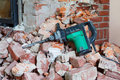 Hammer drill and rubble lying on a lot of Royalty Free Stock Images