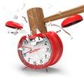 Hammer hitting an alarm clock. Royalty Free Stock Photo