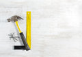 Hammer with nails, ruler. Construction tools. Royalty Free Stock Photo