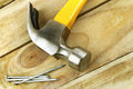 Hammer and nails on wood Stock Photos