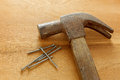 Hammer ,nails on wood background.