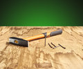 Hammer and nails on the wooden table Royalty Free Stock Photo